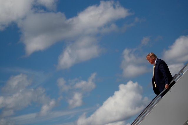 U.S. President Donald Trump steps off Air Force One as he returns to Washington at Joint Base Andrews, Maryland, U.S., June 19, 2019. (Photo by Carlos Barria/Reuters)