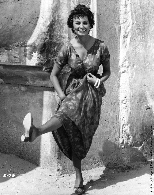 Sophia Loren  the Italian actress lets her hair down between scenes for the film 'Legend of the Lost', in which she co-starred with John Wayne, 1957