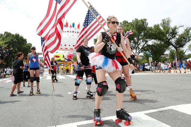 Women in roller derby outfits skate by with national flags during Fourth of July Independence Day celebrations in Washington, D.C., U.S., July 4, 2019. (Photo by Tom Brenner/Reuters)