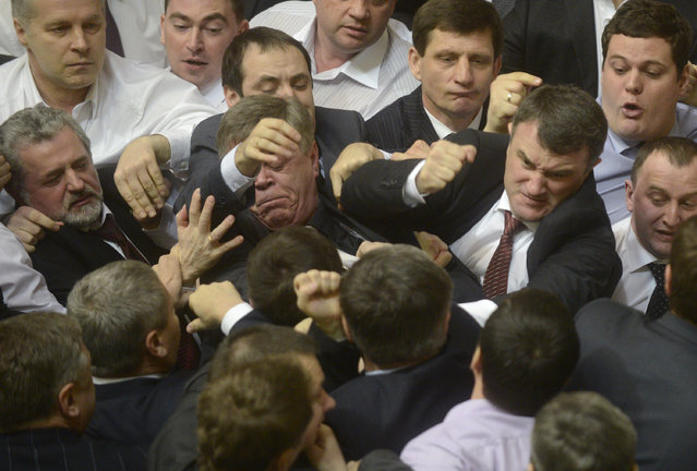 Ukrainian deputies scuffle during a session in the national Parliament in Kiev March 19, 2013. The Parliament was scheduled to debate the date of a mayoral election in Kiev, local media reported. (Photo by Reuters/Stringer)