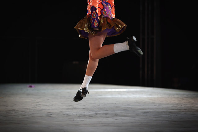 Competitors perform at the World Irish Dance Championship on April 13, 2014 in London, England. The 44th World Irish Dance Championship is currently running at London's Hilton London Metropole hotel, and will host approximately 5,000 dancers competing in solo, Ceili, modern figure choreography and dance drama categories during the week long event. (Photo by Dan Kitwood/Getty Images)
