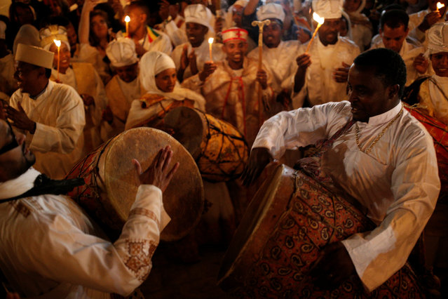 Ethiopian Orthodox worshippers dance during the Holy Fire ceremony at the Ethiopian section of the Church of the Holy Sepulchre in Jerusalem's Old City April 30, 2016. (Photo by Amir Cohen/Reuters)