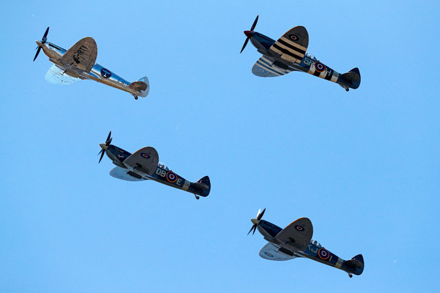 British aviator Matt Jones (L) flies over the airfield, escorted by three other Spitfires based at Goodwood, after taking off in the restored World War II Silver Spitfire plane for a round-the-world flight attempt at Goodwood Aerodrome in Chichester, southeast England, on August 5, 2019. Two British aviators, Steve Brooks and Matt Jones, will take off on August 5, 2019 on a first-ever attempt to fly a Spitfire around the world, proclaiming the iconic fighter plane as a symbol of freedom. The restored plane fought in World War II but has been de-militarised, stripped of its guns and paintwork to reveal the shining, silvery metal underneath. (Photo by Adrian Dennis/AFP Photo)