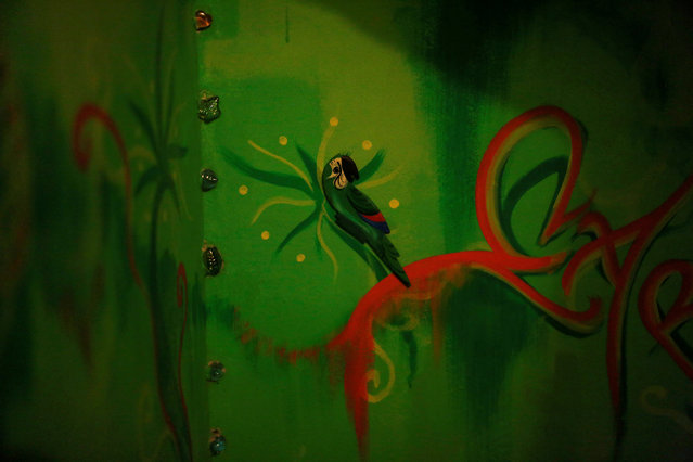 A drawing is seen on a wall at Pousada Favelinha (Little favela) hostel in Pereira da Silva favela, in Rio de Janeiro, Brazil, April 29, 2016. (Photo by Pilar Olivares/Reuters)