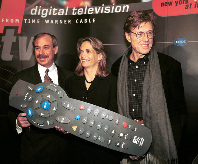 Actor and Director Robert Redford (right) stands with Barry Rosenblum, Time Warner Cable President and Barbara Kelly, Senior Vice President and General Manager of Time Warner Cable at the launch of Digital Television from Time Warner Cable in New York February 17, 2000. (Photo by Jonathan Elderfield/Getty Images)