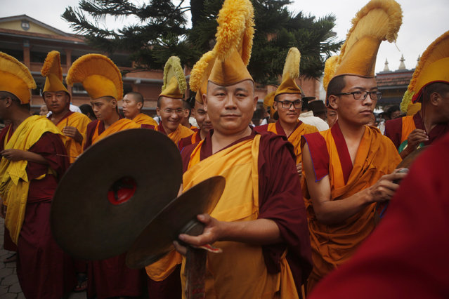 Tibetan monks participate in celebrations to mark the 80th birthday of their spiritual leader, the Dalai Lama, in Kathmandu, Nepal, Monday, July 6, 2015. (Photo by Niranjan Shrestha/AP Photo)