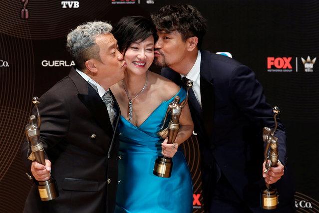 Best Supporting Actor Eric Tsang (L) and Best Actor Gordon Lam (R) pose with Best Actress Kara Wai at the Hong Kong Film Awards in Hong Kong, China April 9, 2017. (Photo by Bobby Yip/Reuters)