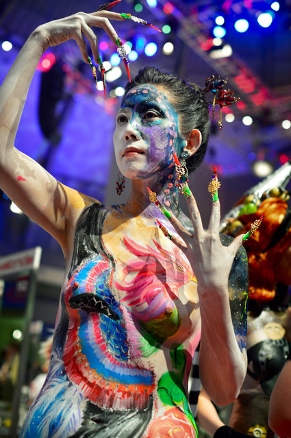 "Model pose after the contest ""Body Painting"" of the OMC Hairworld World Cup on May 4, 2014 in Frankfurt am Main, Germany. The OMC Hairworld World Cup will be held in Frankfurt from 3 to 5 May 2014, parallel to the Hair and Beauty 2014 fair. Around 1.250 participants from 50 countries fight in different contest for the titles. (Photo by Thomas Lohnes/Getty Images)"
