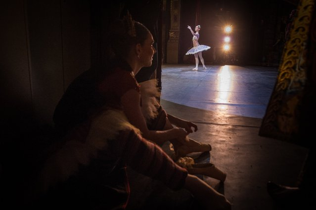 """Dancer of the Hungarian National Ballet Elizaveta Cheprasova (L) watches her colleague Lili Felmery dance during a rehearsal of the ballet """"Le Corsaire"""" by Anna-Marie Holmes, Tamas Solymosi and Adolphe Adam on the stage of the Hungarian State Opera in Budapest, Hungary, 20 April 2017 (issued 28 April). Founded by the International Dance Committee of the International Theatre Institute the International Dance Day has been celebrated on 29 April every year since 1982. (Photo by Bea Kallos/EPA)"""