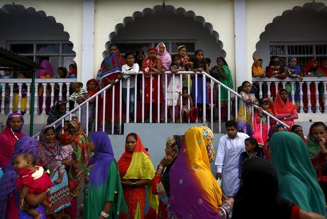 Nepali Muslim women wait to observe the mass prayer during Eid al-Fitr celebrations at a mosque in Kathmandu July 18, 2015. (Photo by Navesh Chitrakar/Reuters)