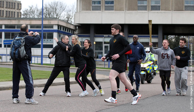 Men stage an attack during a training session for the Olympic Torch Security Team who will be protecting the torch bearers and Olympic flame during the torch relay's progress through the UK, at the Metropolitan Police Training School