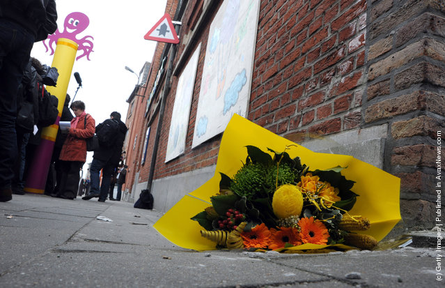 Floral tributes are left at the gates of Sint Lambertus School, following a bus crash that killed 22 children in Switzerland, on March 14, 2012 in Heverlee, Belgium