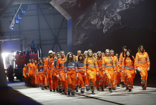 Performers dressed as miners, take part in a show during the opening ceremony of the NEAT Gotthard Base Tunnel, the world's longest and deepest rail tunnel, near the town of Erstfeld, Switzerland June 1, 2016. The 57.1-km (35.5 mile)-long Gotthard Base Tunnel, 17 years under construction and designed to last a century, is part of a 23 billion Swiss franc (23.1 billion USD) infrastructure project to speed passengers and cargo by rail below the Alps, as much as 2.3 km (1.7 miles) under the mountain chain, that divides Europe's north and south. (Photo by Arnd Wiegmann/Reuters)