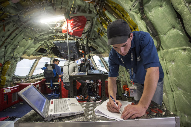 Employees work inside an Airbus A350 XWB aircraft during manufacture at the Airbus Group NV factory in Toulouse, France, on Monday, June 16, 2014. The current European Union (EU) commission is an obstacle to the creation of industry champions, French Economy Minister Arnaud Montebourg stated during a visit to Airbus sites in Toulouse, southwest France, today. (Photo by Balint Porneczi/Bloomberg)