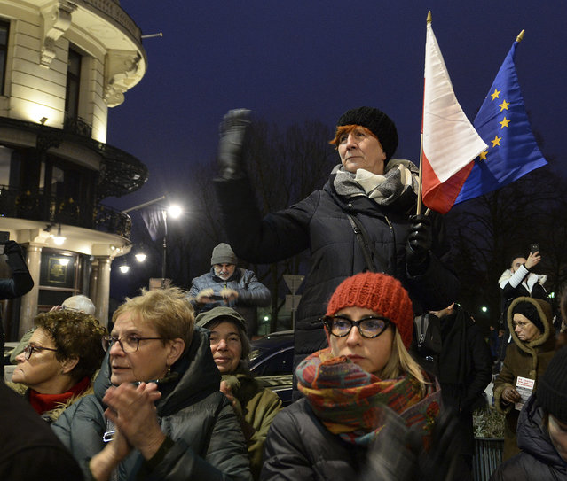 Demonstrators attend a protest by judges and lawyers from across Europe, many of them dressed in their judicial robes, in Warsaw, Poland, Saturday, January 11, 2020. The march was a show of solidarity with Polish judges, who are protesting a bill that would allow the government to fire judges whose rulings they don't like. The legislation has been denounced by the European Union and the United Nations. (Photo by Czarek Sokolowski/AP Photo)