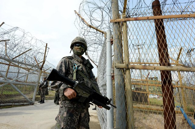 South Korean soldiers patrol along the scene of a blast inside the demilitarized zone separating the two Koreas in Paju, South Korea, in this picture taken on August 9, 2015 by the Defense Ministry and released by Yonhap on August 10, 2015. (Photo by Reuters/Yonhap/Defense Ministry)