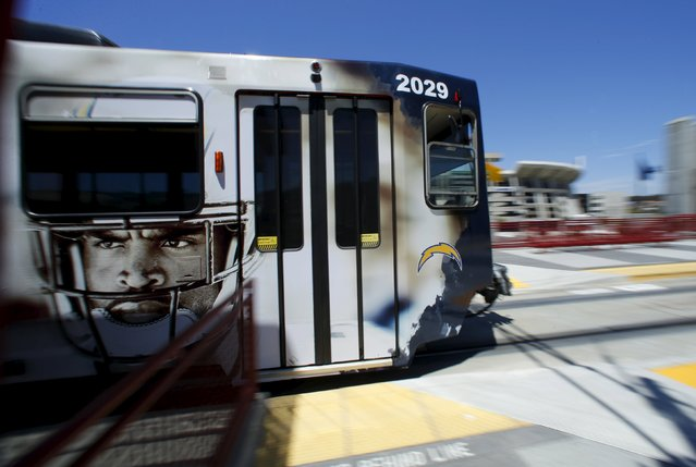 A San Diego Charger-themed trolly, wrapped to promote the NFL teams 2015 season, leaves the teams home stadium stop in San Diego, California, August 11, 2015. As the Chargers make plans to leave San Diego for a new stadium proposed for Los Angeles the city of San Diego is dealing with the pressure of having to build a new stadium to keep the team. (Photo by Mike Blake/Reuters)