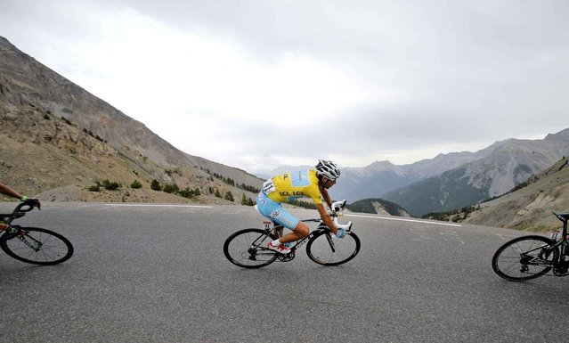 Italy's Vincenzo Nibali, wearing the overall leader's yellow jersey, speeds down Izoard pass during the fourteenth stage of the Tour de France cycling race over 177 kilometers (110 miles) with start in Grenoble and finish in Risoul, France, Saturday, July 19, 2014. (Photo by Christophe Ena/AP Photo)