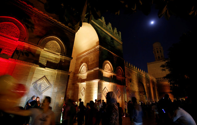 People celebrate after their iftar (breaking fast) meal during the Muslim fasting month of Ramadan in front of Al-Hakim bi-Amr Allah Mosque, in old Cairo, Egypt June 16, 2016. (Photo by Amr Abdallah Dalsh/Reuters)