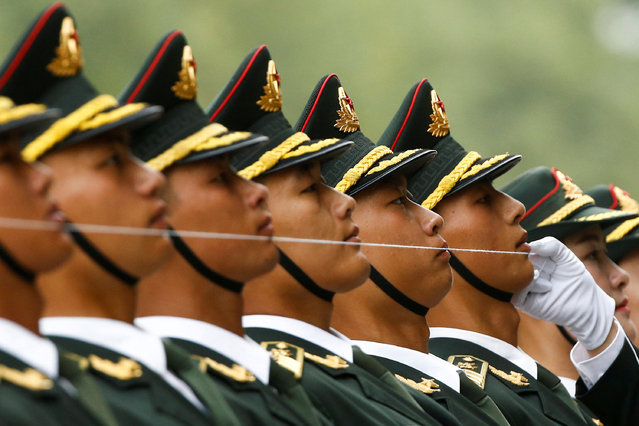 Chinese honour guards prepare for a welcoming ceremony for Brazil's President Michel Temer (not pictured) at the Great Hall of the People in Beijing, China, September 1, 2017. (Photo by Thomas Peter/Reuters)
