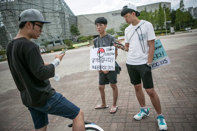 South Korean youths who makes allowance by subsituting the process of opening the eggs in the first few kilometers of Pokemon Go wait for customers on July 15, 2016 in Sokcho, South Korea. (Photo by Jean Chung/Getty Images)