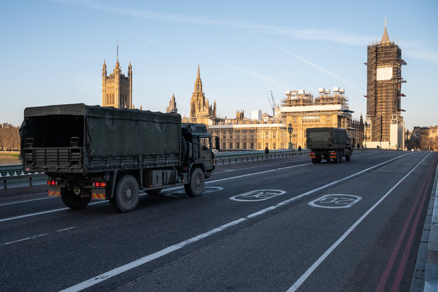 Military vehicles cross Westminster Bridge after members of the 101 Logistic Brigade of the British Army delivered a consignment of medical masks to St Thomas' hospital on March 24, 2020 in London, England. British Prime Minister, Boris Johnson, announced strict lockdown measures urging people to stay at home and only leave the house for basic food shopping, exercise once a day and essential travel to and from work. The Coronavirus (COVID-19) pandemic has spread to at least 182 countries, claiming over 10,000 lives and infecting hundreds of thousands more. (Photo by Leon Neal/Getty Images)