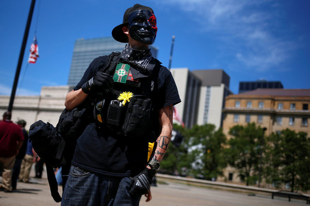 A demonstrator stands during a rally outside the Republican National Convention in Cleveland, Ohio, U.S., July 18, 2016. (Photo by Shannon Stapleton/Reuters)