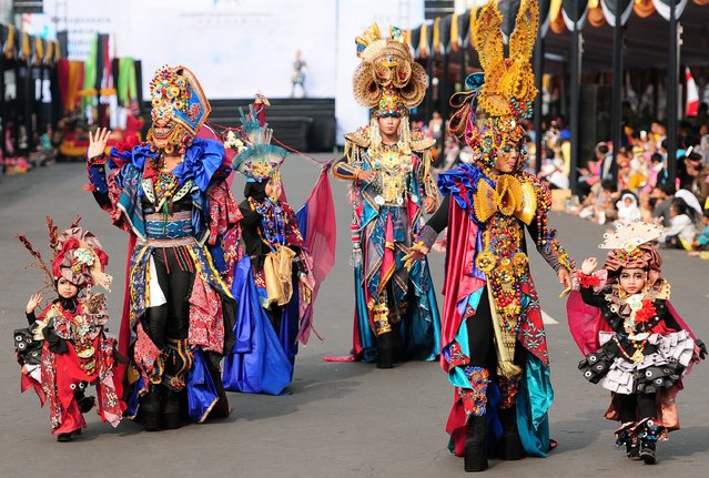Models wear Tambora costumes in the kids carnival during The 13th Jember Fashion Carnival 2014 on August 21, 2014 in Jember, Indonesia. (Photo by Robertus Pudyanto/Getty Images)