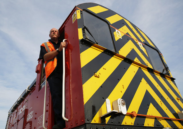 Freight train driver Chris Bingham poses for a photograph at the Hoo Junction Marshalling Yard near Gravesend in southern England July 16, 2014. (Photo by Luke MacGregor/Reuters)