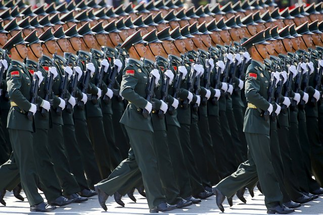Soldiers of the People's Liberation Army (PLA) of China march at Tiananmen Square during the military parade marking the 70th anniversary of the end of World War Two, in Beijing, China, September 3, 2015. (Photo by Damir Sagolj/Reuters)