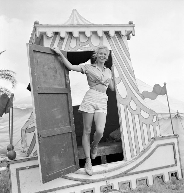 A circus girl standing at a door of a circus vehicle during a rehearsal for the Ringling Bros. and Barnum & Bailey Circus in Sarasota, FL in 1949. (Photo By Nina Leen/Time Life Pictures/Getty Images)