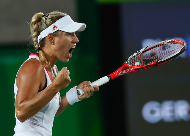 Germany's Angelique Kerber reacts after winning a set against Monica Puig of Puerto Rico in the gold medal match of the women's tennis competition at the 2016 Summer Olympics in Rio de Janeiro, Brazil, Saturday, August 13, 2016. (Photo by Vadim Ghirda/AP Photo)