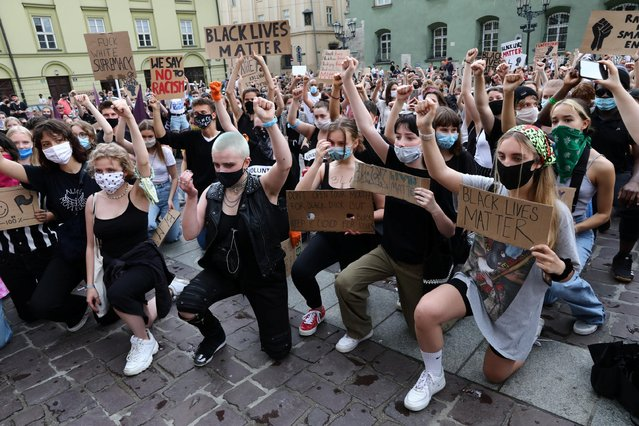 People hold placards during a protest against racial inequality in the aftermath of the death in Minneapolis police custody of George Floyd in Krakow, Poland on June 7, 2020. (Photo by Jakub Porzycki/Agencja Gazeta via Reuters)