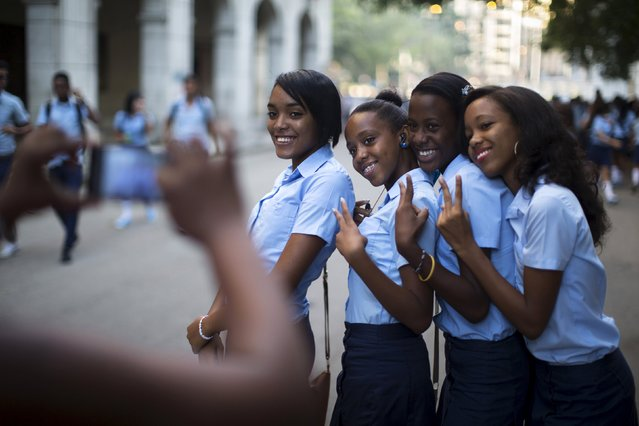 Pre-university students pose for a photo during the first day of class for the 2015-2016 course in downtown Havana, September 1, 2015. (Photo by Alexandre Meneghini/Reuters)