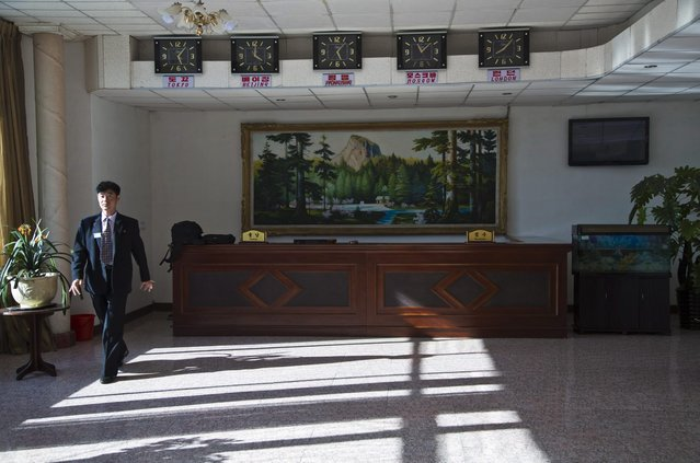 In this June 19, 2014 photo, a hotel employee walks in the lobby of a hotel that accommodates foreign visitors in Chongjin, North Korea. (Photo by David Guttenfelder/AP Photo)