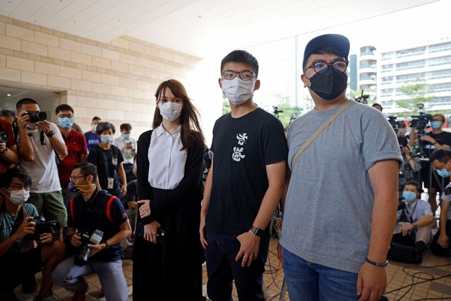 From left; pro-democracy activists Agnes Chow, Joshua Wong and Ivan Lam arrive at a court in Hong Kong, Wednesday, August 5, 2020. Chow appeared for sentencing after she pleaded guilty to inciting others to participate in an unlawful assembly, as well as to participating in an unauthorized assembly, related to protests in June last year. (Photo by Kin Cheung/AP Photo)