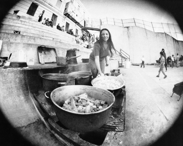 Fisheye view of Lorraine Parrish of Berkeley preparing stew in Alcatraz courtyard in San Francisco, November 30, 1969 as American Indians continue swelling the population of the former federal prison. Newsmen were barred from the Rock as Indians declared a day of relaxation. (Photo by AP Photo)