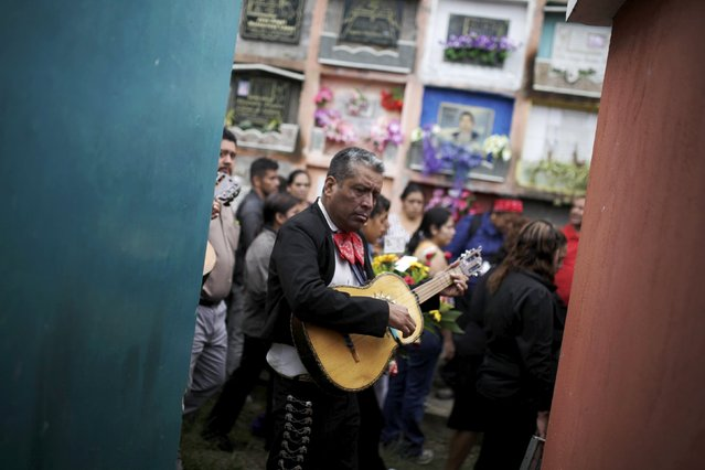 A man plays a mariachi during the funeral of members of the Sandoval family, mudslide victims in Santa Catarina Pinula, on the outskirts of Guatemala City, October 4, 2015. (Photo by Josue Decavele/Reuters)