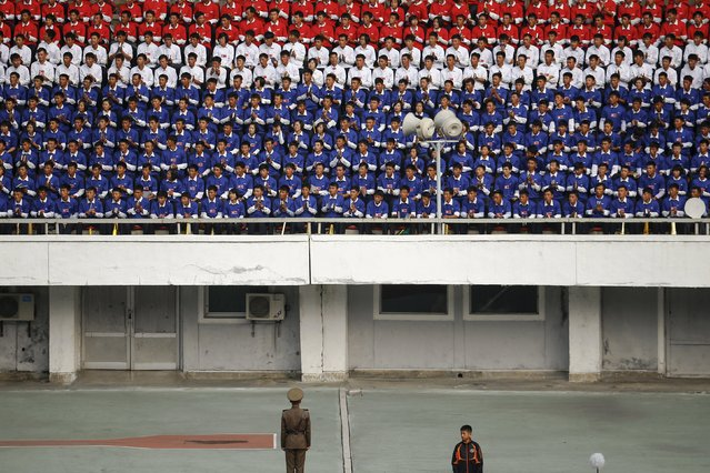 North Korean fans in national colours watch their team's preliminary 2018 World Cup and 2019 AFC Asian Cup qualifying soccer match against Philippines at the Kim Il Sung Stadium in Pyongyang October 8, 2015. (Photo by Damir Sagolj/Reuters)