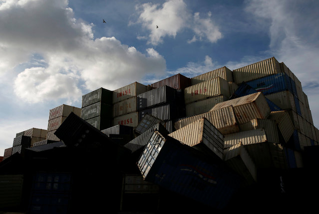 Birds fly over the toppled shipping containers after Typhoon Meranti made landfall, in Kaohsiung, Taiwan September 15, 2016. (Photo by Tyrone Siu/Reuters)