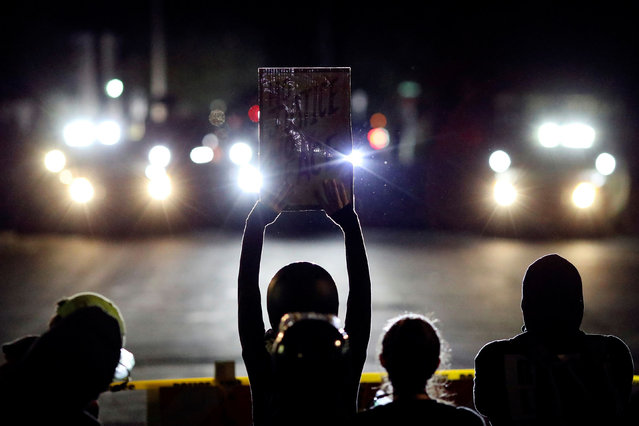 A demonstrator holds up a sign outside the Portland Police Bureau's North Precinct on the 101th consecutive night of protests against police violence and racial inequality, in Portland, Oregon, U.S. September 6, 2020. (Photo by Caitlin Ochs/Reuters)
