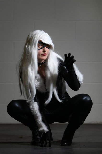 An actress dressed as Black Cat poses for a photo at the London Super Comic Convention at the ExCeL Centre on February 23, 2013 in London, England. Enthusiasts at the Comic Convention are encouraged to wear a costume of their favourite comic character and flock to the ExCeL to gather all the latest news in the world of comics, manga, anime, film, cosplay, games and cult fiction. (Photo by Jordan Mansfield)