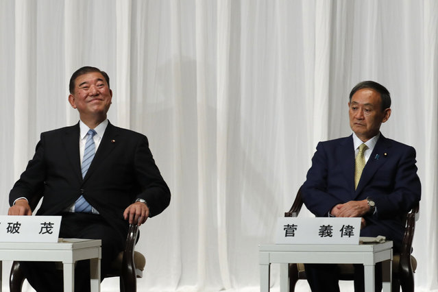 Japanese Chief Cabinet Secretary Yoshihide Suga, right, and former Defense Minister Shigeru Ishiba attend a speech session for the Liberal Democratic Party's (LDP) leadership election with former Foreign Minister Fumio Kishida at its headquarters in Tokyo Tuesday, September 8, 2020. The official campaigning to lead Japan's ruling party began Tuesday with the longtime right-hand man of Prime Minister Shinzo Abe now seen as a top candidate and his likely successor to lead the government. (Photo by Kim Kyung-hoon/Pool Photo via AP Photo)