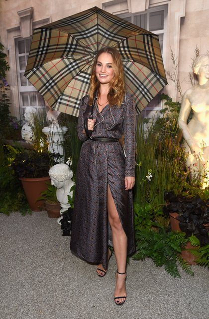 Lily James wearing Burberry at the Burberry September 2016 show during London Fashion Week SS17 at Makers House on September 19, 2016 in London, England. (Photo by David M. Benett/Getty Images for Burberry)