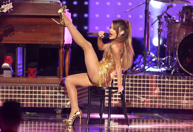 Ariana Grande performs at the 42nd annual American Music Awards at Nokia Theatre L.A. Live on Sunday, November 23, 2014, in Los Angeles. (Photo by Matt Sayles/Invision/AP Photo)
