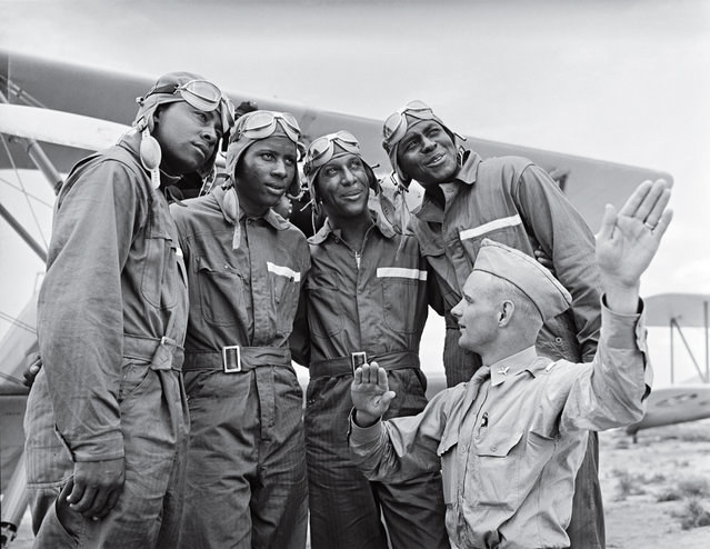 Lt. McCune instructing cadets in training for US Army Air Corps 99th Pursuit Squadron, 1st all-black combat pilot unit (African-Amer. fliers of WWII Tuskegee airmen fame), about air currents at flight school, 1942. (Photo by Gabriel Benzur/Time & Life Pictures)