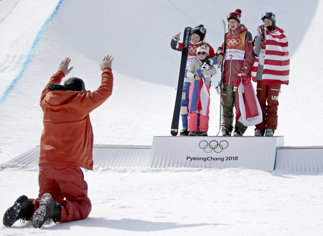 (L-R, back) Silver medal winner Marie Martinod of France with daughter Melirose, gold medal winner Cassie Sharpe of Canada and bronze medal winner Brita Sigourney of the USA celebrate on the podium as Martinod's partner, Max (L, foreground), reacts before them during the venue ceremony after the Women's Freestyle Skiing Ski Halfpipe competition at the Bokwang Phoenix Park during the PyeongChang 2018 Olympic Games, South Korea, 20 February 2018. (Photo by Fazry Ismail/EPA/EFE)