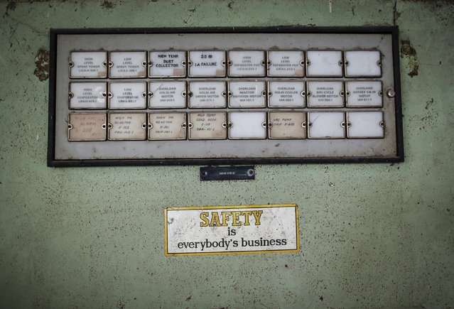 A sticker is seen next to a panel in the control room of the abandoned former Union Carbide Corp pesticide plant in Bhopal November 14, 2014. (Photo by Danish Siddiqui/Reuters)