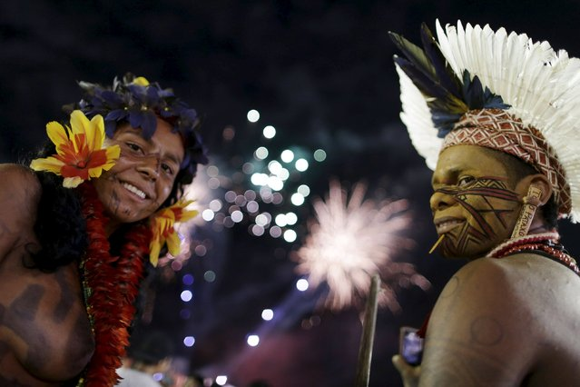 Indigenous people are seen watching fireworks during the first World Games for Indigenous Peoples in Palmas, Brazil, October 24, 2015. (Photo by Ueslei Marcelino/Reuters)