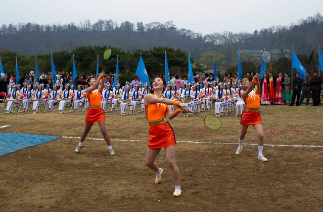 Women perform a dance routine with badminton rackets at an event to mark the birthday of Kim Il Sung at a park in Pyongyang, North Korea, on April 15, 2011. (Photo by David Guttenfelder/AP Photo)